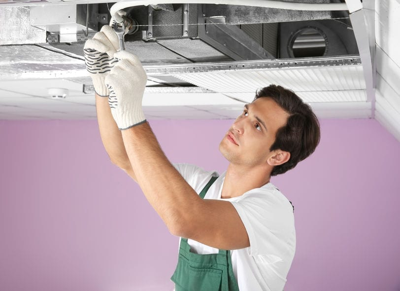 technician performing ac tune up
